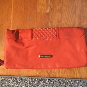 Steve Madden fold-over clutch in vegan leather.